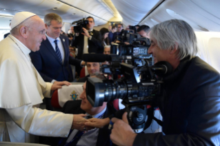 0-Apostolic Journey to the United Arab Emirates: Greeting to journalists on the flight to Abu Dhabi