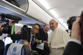 4-Apostolic Journey to Morocco: Greeting to journalists on the flight to Rabat