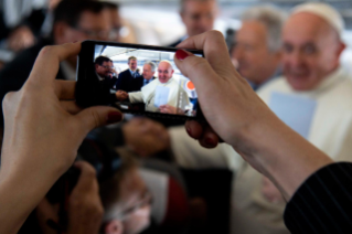 6-Apostolic Journey to Panama: Greeting to journalists on the flight to Panama